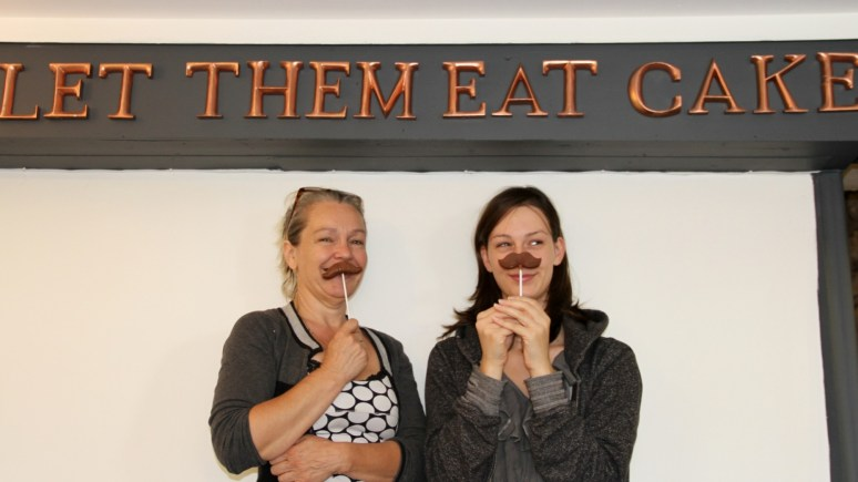 Sweet treats (L-R): owner Debrah Green and shop assistant Rebecca Frost with chocolate moustaches. Photo: Emily Norton