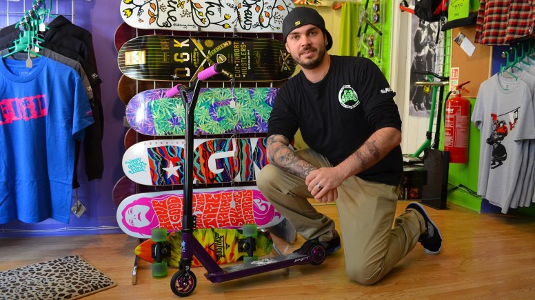 Grindhaus owner Karl Barkworth with the new range of Grit scooters and Steak boards. Photo: Emily Norton