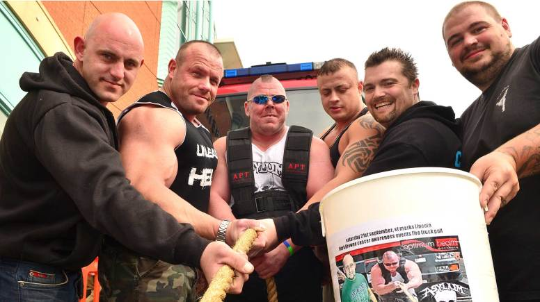 Lincoln strongman pulls fire truck for charity