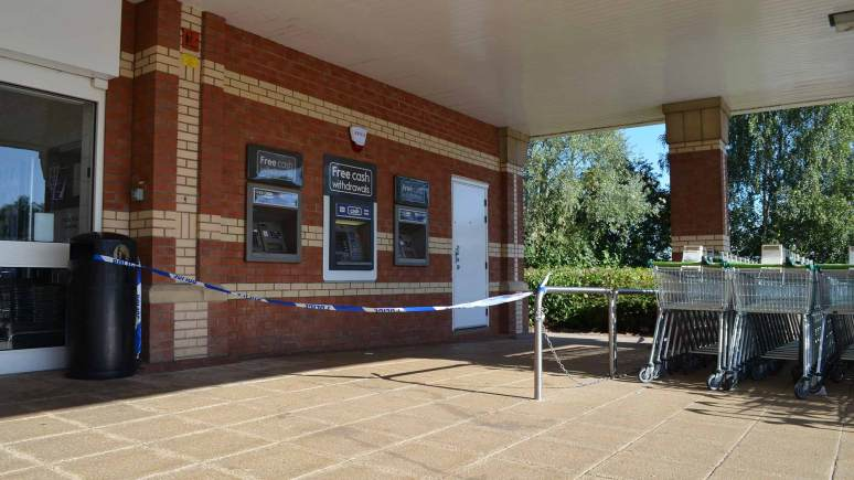 Lincolnshire Police taped off the cash machines at the Waitrose supermarket in Lincoln on September 9, 2013.
