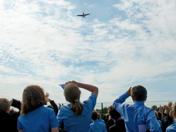 William Farr students watch the Spitfire flypast.