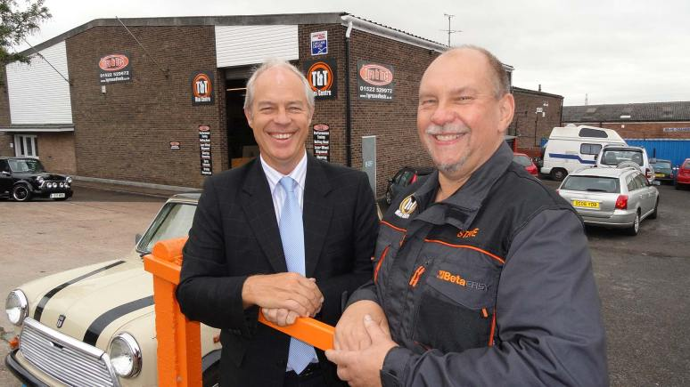 Done deal: Tyre & Tech Managing Director Steve Hoe with Russell Payne of Russell Payne Chartered Accountants.