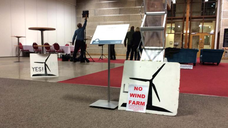 Campaigners for and against the wind farm signs at the special planning meeting at Lincolnshire Showground in October 2013.