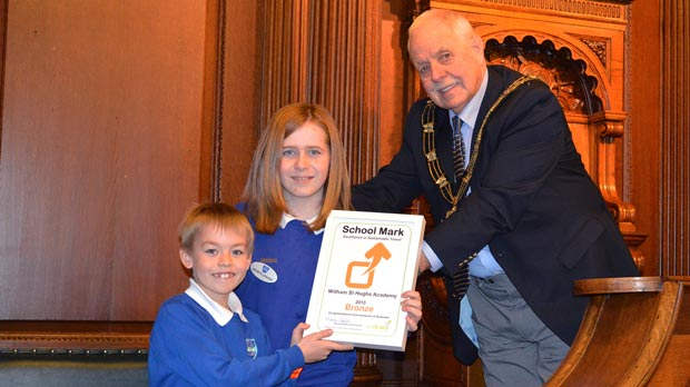 Witham St Hughs Academy collecting their award from Cllr Patrick Vaughan, Mayor of Lincoln.