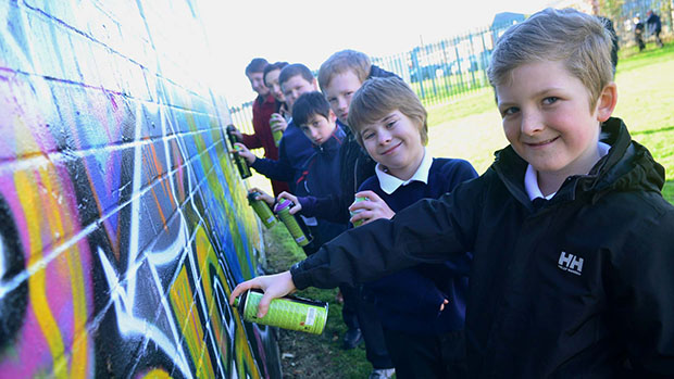 Local schoolchildren graffiti different ways of saying hello on a wall. Photo: Steve Smailes for The Lincolnite.