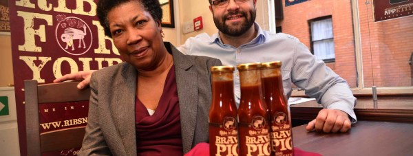 Jenny Smith of Jenny's Jams with Adam Morgan, Ribs 'n' Bibs restaurant owner. Photo: Steve Smailes for The Lincolnite
