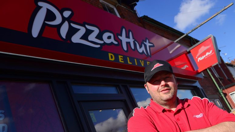Ian Smith outside the new pizza Hut Delivery shop. Photo: Steve Smailes for The Lincolnite.