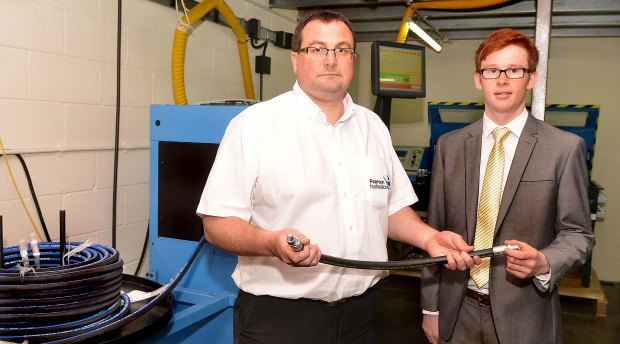 Pearson Hydraulics' Managing Director Rick Dring shows Banks Long & Co Trainee Surveyor Jonathan Purkiss the capabilities of the firm's new £100,000 hose-cutting machine.