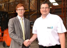 (L-R) Banks Long & Co Trainee Surveyor Jonathan Purkiss shaking hands with Pearson Hydraulics'                                Managing Director Rick Dring in the new premises.