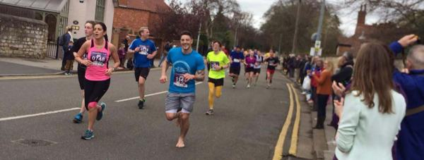 Chris running the 10k without shoes proved a painful fundraising experience.