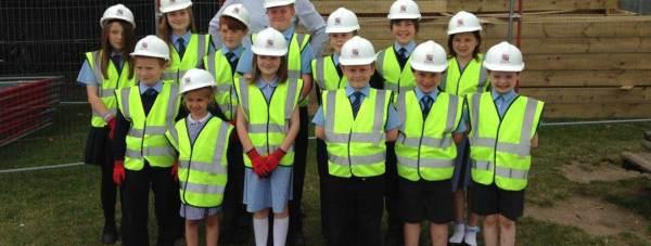 John Hallam of Simons Group with St Hughs schoolchildren.