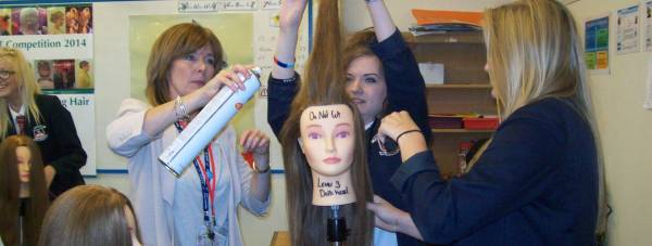 Pupils during a hairdressing taster session during Workforce Day 2014.
