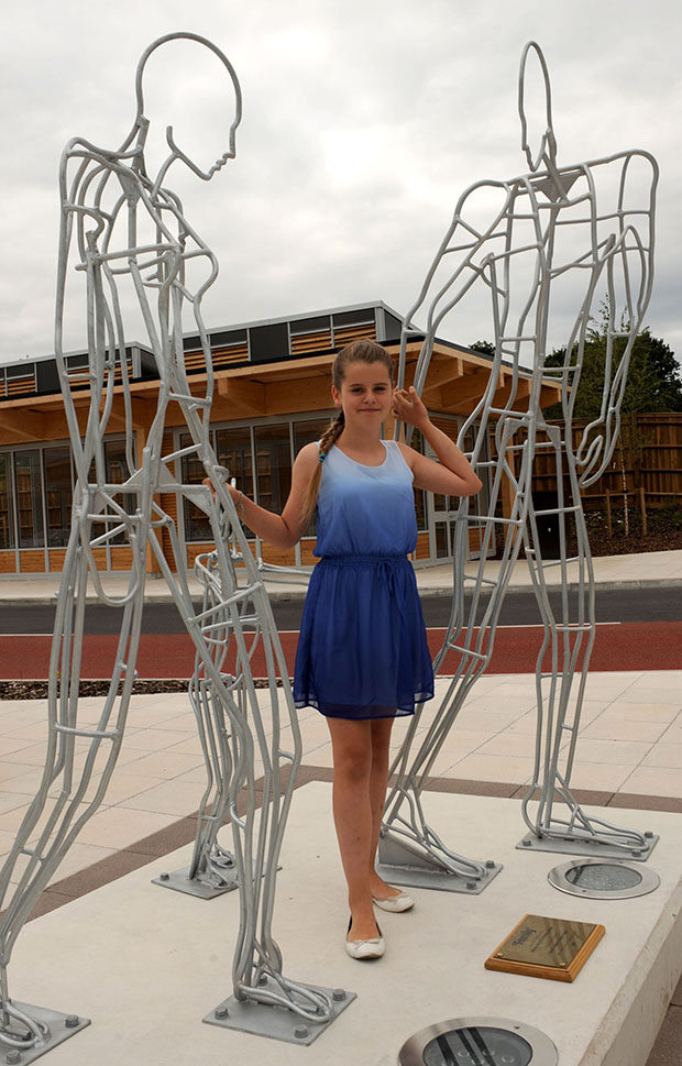 Satine Aldwinkle  (22) with her sculpture family.