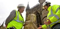 Works Manager at Lincoln Cathedral, Carol Heidschuster and stone conservator Neil Bywater at the Swineherd of Stow. Photo: Steve Smailes for The Lincolnite