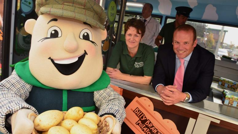 Billy Branston on his Amazing Potato Factory tour bus with Branston Communications Manager Jackie Baker and Sales and Marketing Director James Truscott. Photo: Steve Smailes for The Lincolnite