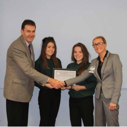 Headteacher Martin Connor with two Year 11 students, Louise and Alisha, and Ms Melling from Sam Learning. Photo: North Kesteven School
