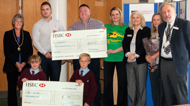 (L-R) Vice Chairman,Cllr Mrs Gill Ogden, George Brown (D Brown), Kurt Mason (D Brown), Emma Young (Lincs and Notts Air Ambulance), Deputy Headteacher, William Alvey, Lesley Browning (Tenant), Mrs Jo Betts Cllr Stewart Ogden. (Front): William Alvey students, Sophie and Mackenzie