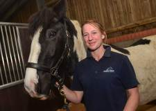 Rehoming team leader Sarah Hackney with one of the new barn's residents. Photo: Steve Smailes for The Lincolnite