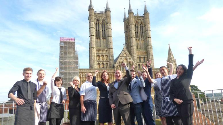 Ian Robinson, General Manager at the White Hart Hotel and Emma Tatlow, Visit Lincoln Partnership manager with White Hart Hotel staff who are taking part in the programme.