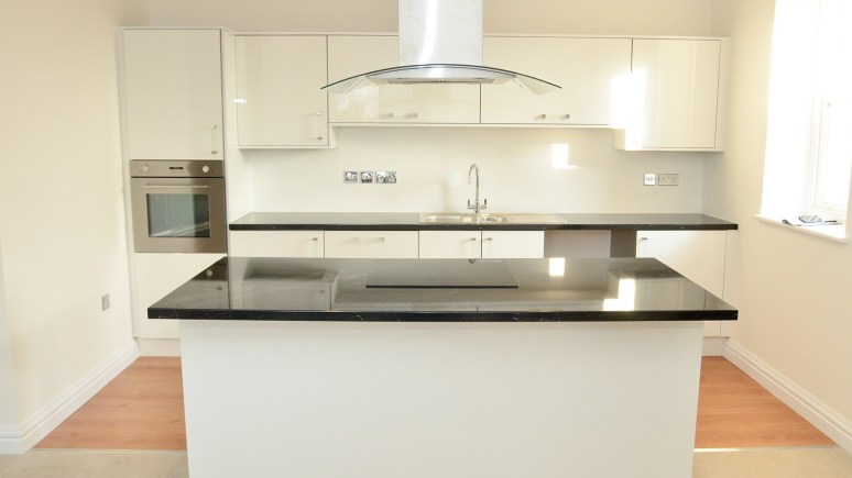 Kitchen in two bed apartment: Photos by Steve Smailes