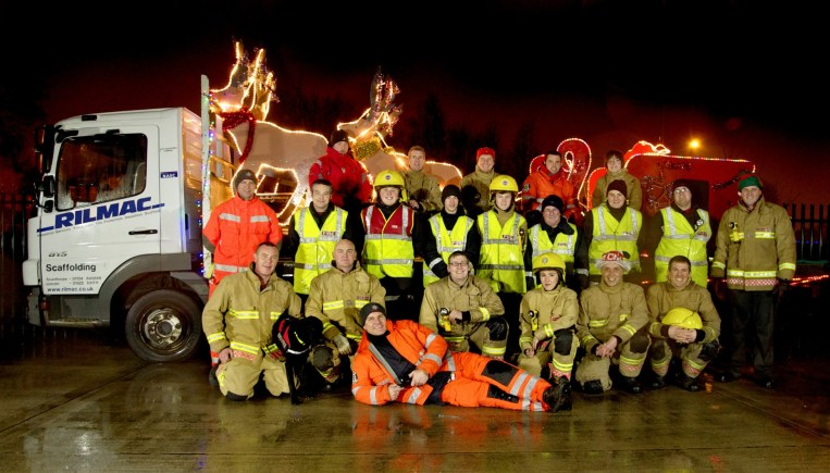 The Lincoln North Fire and Rescue team with Santa's charity tour sleigh. Photo: Lincs F&R