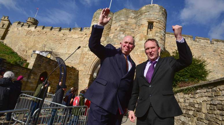 Councillor Colin Davie and Councillor Nick Worth celebrating the opening day of Lincoln Castle after a £22 million revamp. Photo: Steve Smailes for The Lincolnite