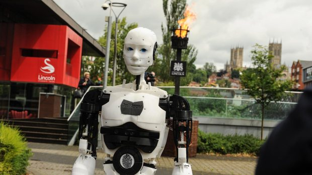 MARC the robot lighting the beacon. Photo: Steve Smailes for The Lincolnite