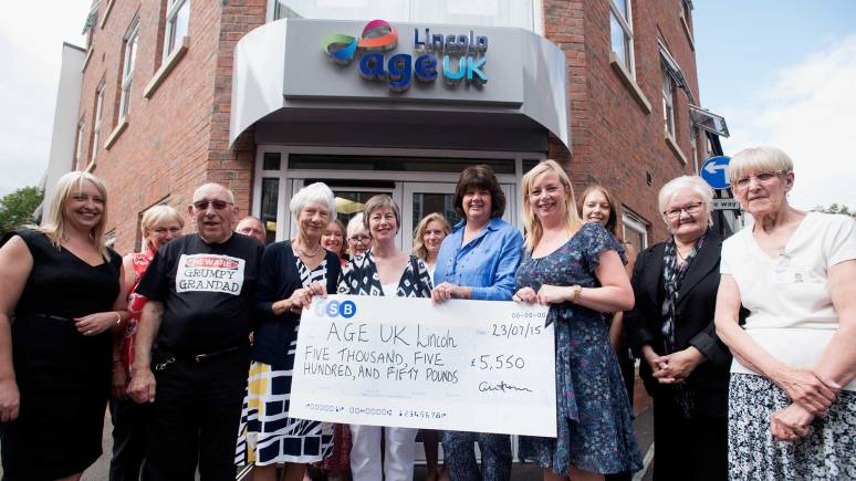 Age UK volunteers received the donation to help with their companionship service. Photo: Steve Smailes for The Lincolnite