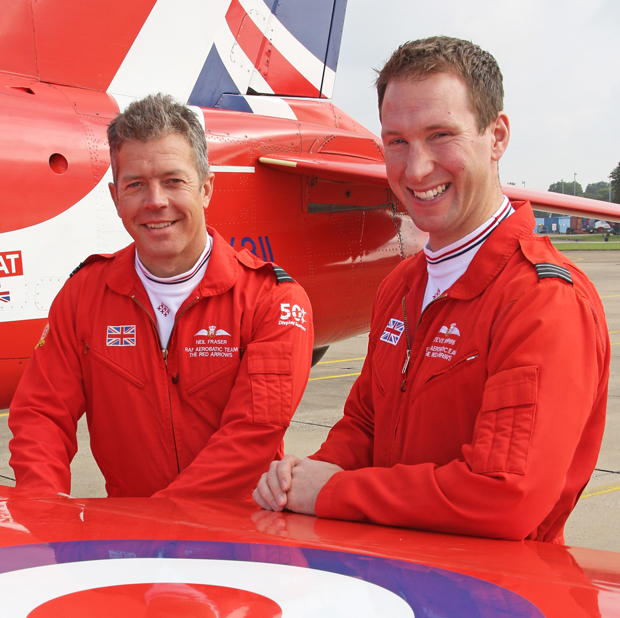 Flight Lieutenant Si Taylor (left) and Flight Lieutenant Matt Masters (right), who are joining the Royal Air Force Aerobatic Team as display pilots for the 2016 season, stand in front of a Red Arrows Hawk jet. Picture by Corporal Steve Buckley – MoD/Crown Copyright 2015.