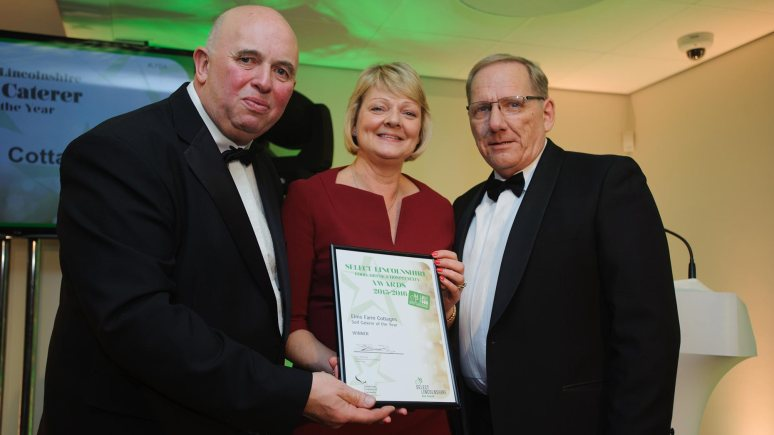 Colin Davie, Executive Councillor for Economic Development, Environment, Strategic Planning and Tourism at Lincolnshire County Council presenting the award for Self Caterer of the Year to Elms Farm Cottages. Photo: Steve Smailes for The Lincolnite