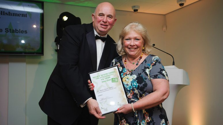 Colin Davie, Executive Councillor for Economic Development, Environment, Strategic Planning and Tourism at Lincolnshire County Council presenting the award for Teaching Establishment of the Year to Manor Farm Stables. Photo: Steve Smailes for The Lincolnite