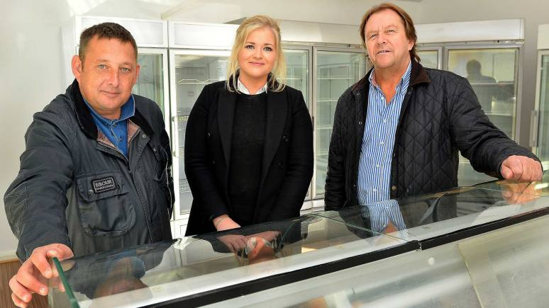 Banks Long & Co Surveyor Harriet Hatcher with                                                      Lincoln Seafood Centre owners (left) Mark Vandeville and (right) Kevin Gray