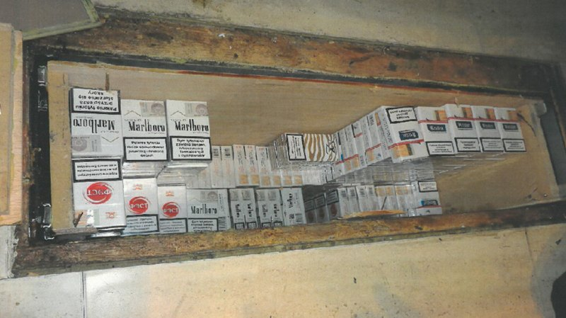 Around 400 packets of cigarettes were discovered in an underground bunker in the Lincoln shop.