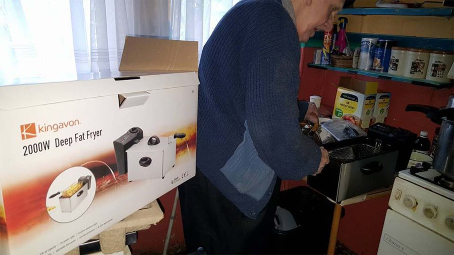 Reg Esberger with his new deep fat fryer. Photo: Micky Richards