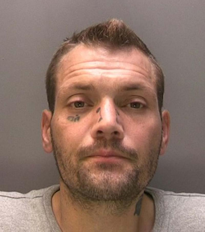 "Mark McKenzie has distinctive facial tattoos of ""oi!"" under his eye and two mini scrolls either side of his nose. Photo: Lincolnshire Police"