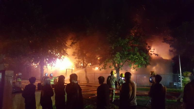 By 11.30pm the building had collapsed and surrounding trees had begun to catch alight. Photo: Zoe Clarke