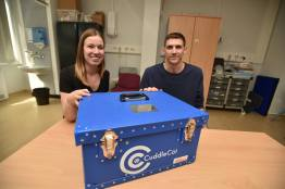 Kirsty and Phil Dulling with the cuddle cot they donated in memory of Cassie Eve. Photo: Steve Smailes for The Lincolnite