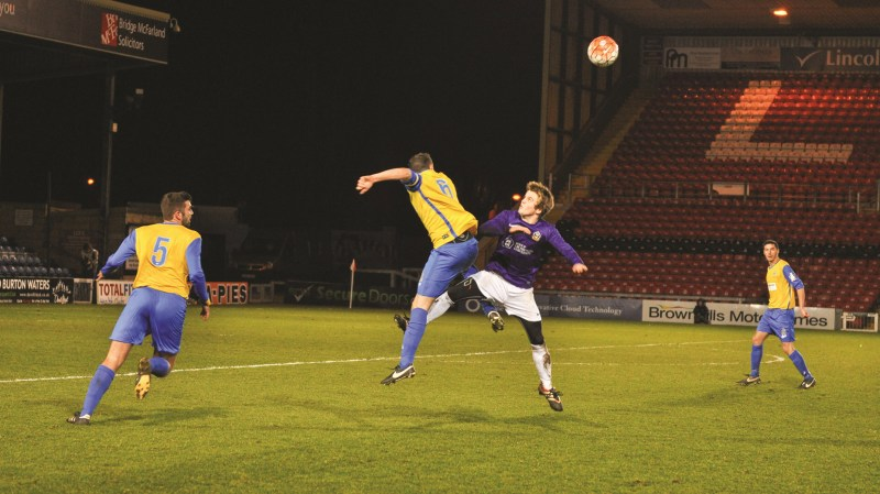 Action from the first Cathedral Cup match at Sincil Bank in February