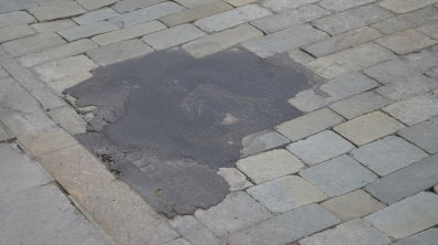 Patchwork has previously been carried out where holes have formed in the road.