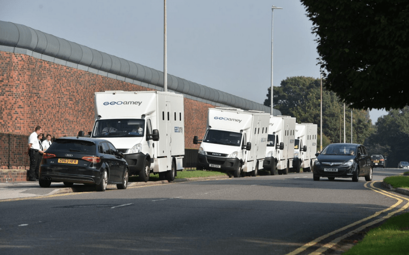 Prisoner transport vans have arrived on the scene outside the prison. Photo: Steve Smailes for The Lincolnite
