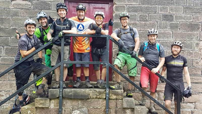 Rob Hudson (centre in orange shirt) with mountain biking friends who have so far raised more than £4,000 to thank Yorkshire Air Ambulance.