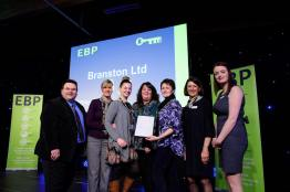 Branston Ltd collect their award from guest speaker David Hyner, left, Elaine Lilley, chief executive of The EBP, second in from right, and Kayleigh Wells, The EBP's work experience co-ordinator, right. Photo: Chris Vaughan
