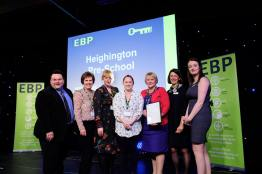 Heighington Pre-School collect their award from guest speaker David Hyner, left, Elaine Lilley, chief executive of The EBP, second in from right, and Kayleigh Wells, The EBP's work experience co-ordinator, right. Photo: Chris Vaughan