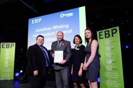 Jonathan Whiting Independent Funeral Directors LTD collect their award from guest speaker David Hyner, left, Elaine Lilley, chief executive of The EBP, second in from right, and Kayleigh Wells, The EBP's work experience co-ordinator, right. Photo: Chris Vaughan