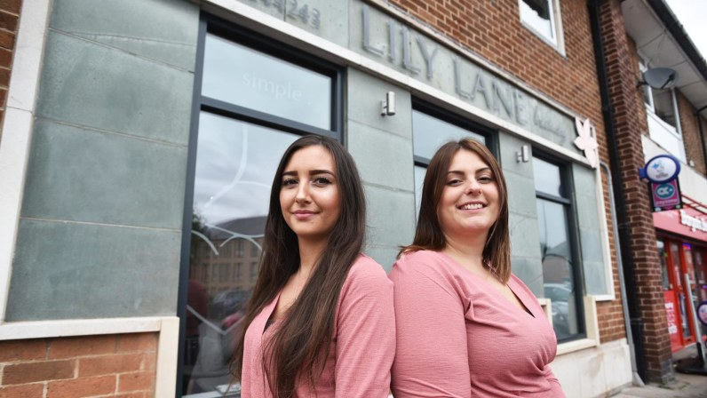 Owner Amy (right) and apprentice Kayla outside the new salon. Photo: Steve Smailes for The Lincolnite
