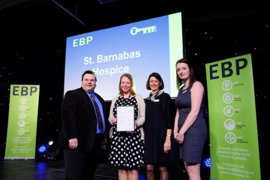St Barnabas Hospice collect their award from guest speaker David Hyner, left, Elaine Lilley, chief executive of The EBP, second in from right, and Kayleigh Wells, The EBP's work experience co-ordinator, right. Photo: Chris Vaughan