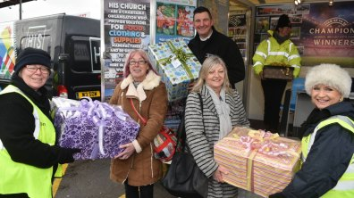 Women from His church (left) and Lincolnshire Women's aid refuge (right) the parcels of clothes and hygiene products. Photo: Steve Smailes for The Lincolnite