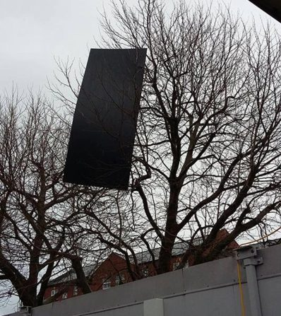 A sheet of metal has been blown into a tree near the old bus station. Photo: Neville Eaglen
