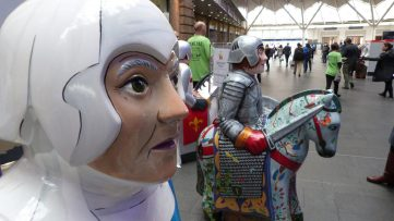 The Lincoln Knights are inside King's Cross Station.