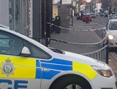 Police rush to Lincoln High Street after woman 'stabbed herself'